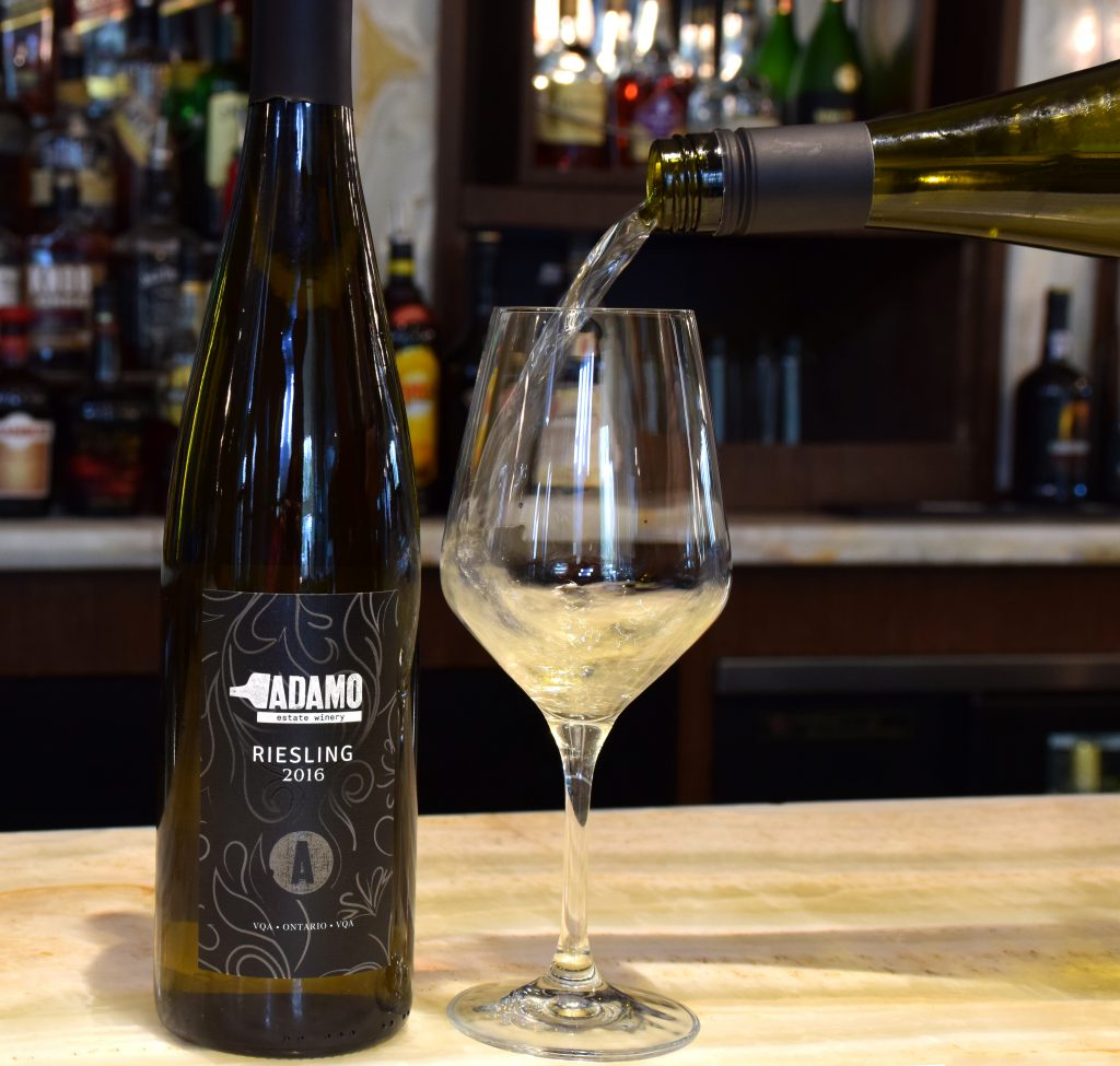 Riesling bottle and pouring wine into a glass