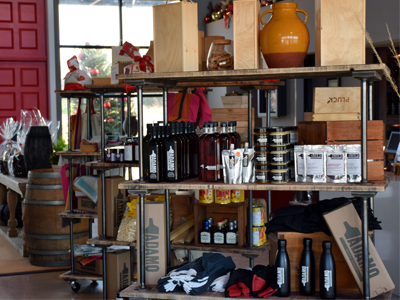 retail shelves with assorted items at Adamo Estate Resort